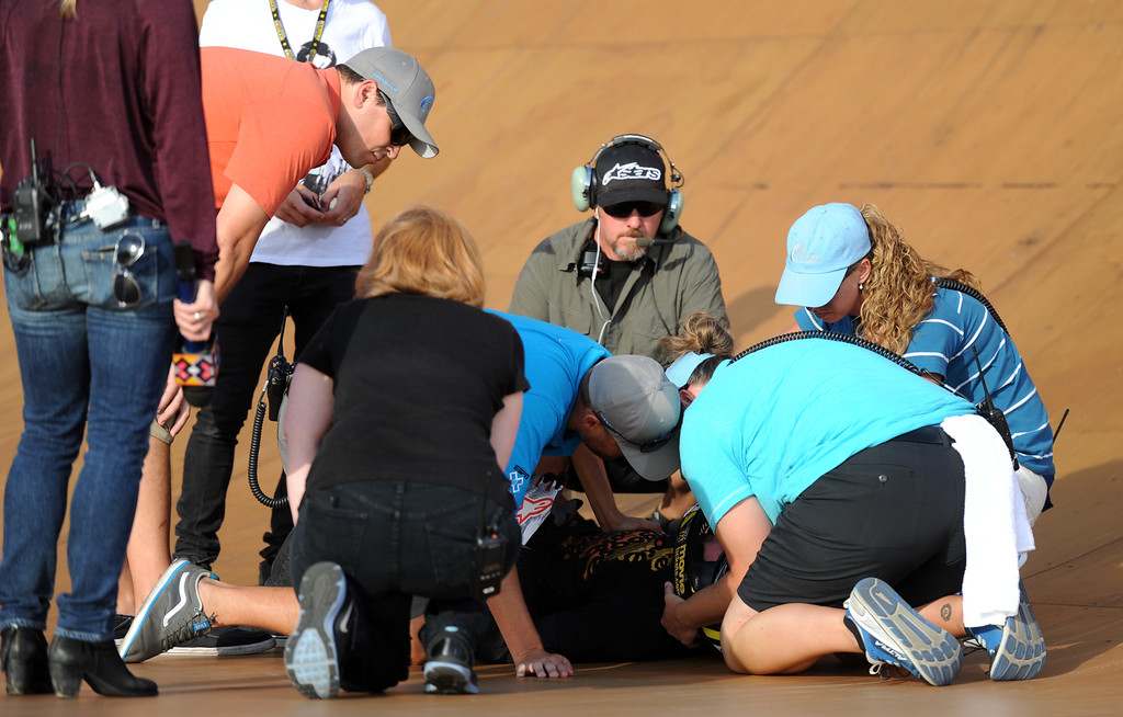 . Xgame personnel looks over Steve McCann after he crashed on his first run and would not return during the GoPro BMX Big Air Final at Irwindale Speedway on Friday, Aug. 2, 2013 in Irwindale, Calif. Morgan Wade won the gold medal.