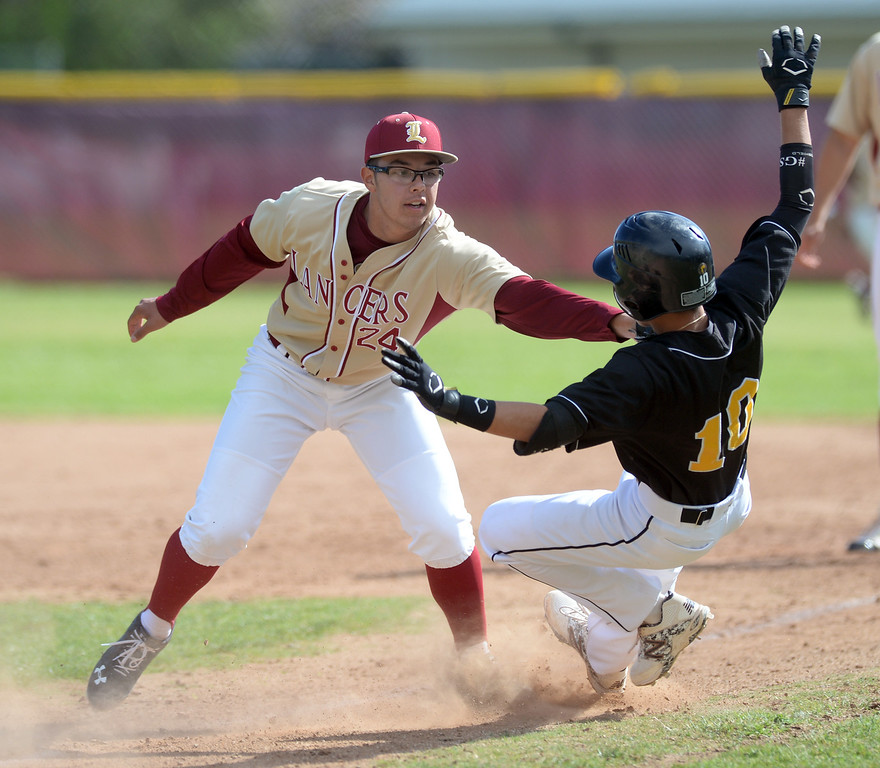 . La Serna\'s Enrique Pacheco (#24) tags out Santa Fe\'s Viktor Arreola (#10) trying to get to first base in their Del Rio League baseball game at La Serna High School in Whittier on Wednesday April 2, 2014. Santa Fe defeated La Serna 2-0. (Staff Photo by Keith Durflinger/Whittier Daily News)