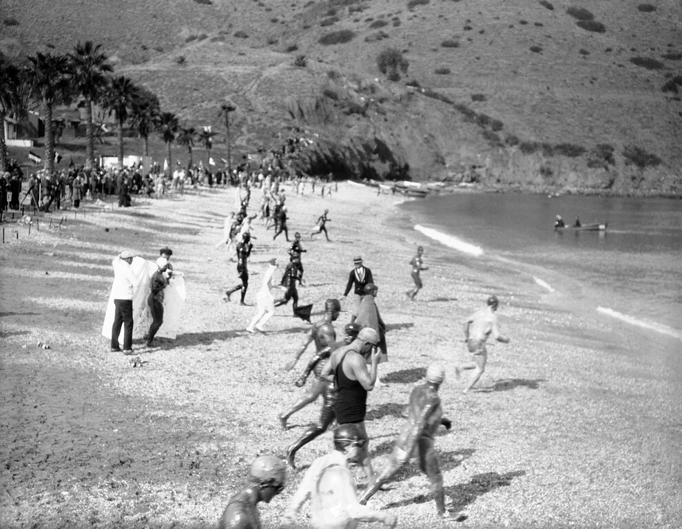 . The start of the grueling Wrigley $40,000 Catalina Channel Swim race at Catalina Island, Calif., on Jan. 20, 1927. In the foreground to the left may be seen Mrs. Lottie Schoemmel, of New York, in her much discussed �suit� of grease as she discards her wrap. Mrs. Schoemmel had to be hauled from water the when she developed a cramp. (AP Photo)