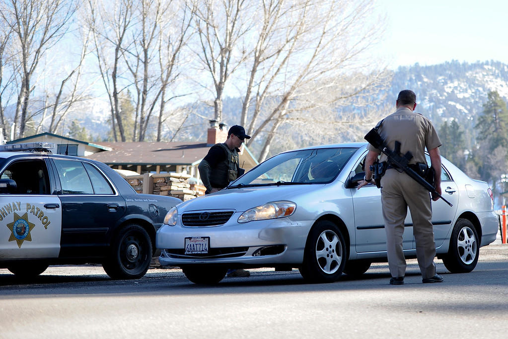 . Authorities evacuate Bear Mountain as the manhunt for Dorner continues in Big Bear on Thursday, Feb. 7, 2013. (Staff photo by Rachel Luna/The Sun)