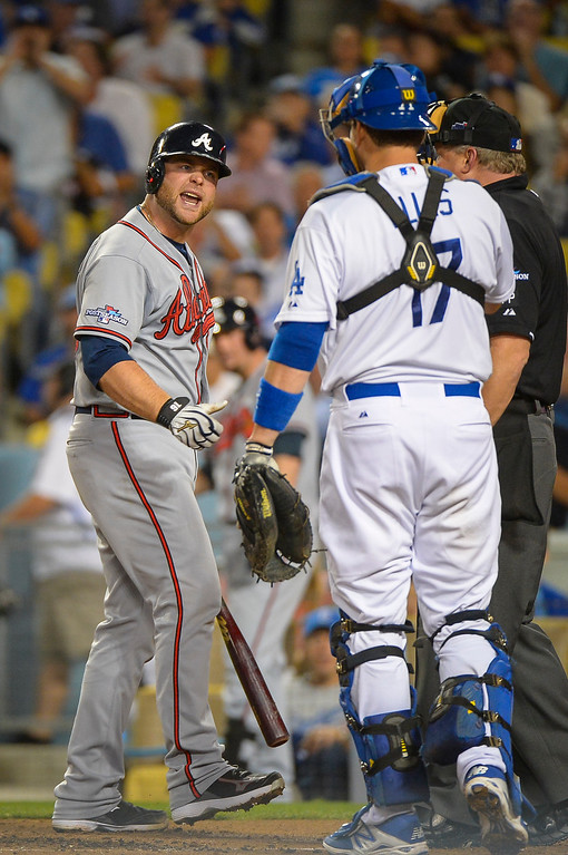 . Atlanta\'s Brian McCann argues with Dodger\'s A.J. Ellis after striking out during game action Monday, October 7, 2013 ( Photo by Andy Holzman/Los Angeles Daily News )
