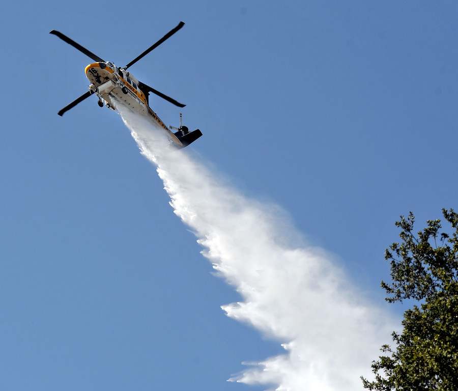 . A Los Angeles County helicopter drops water as they work to extinguish a 6.9 acre brush fire in La Verne on Friday September 13, 2013.  (Whittier Daily News/Staff Photo by Keith Durflinger)