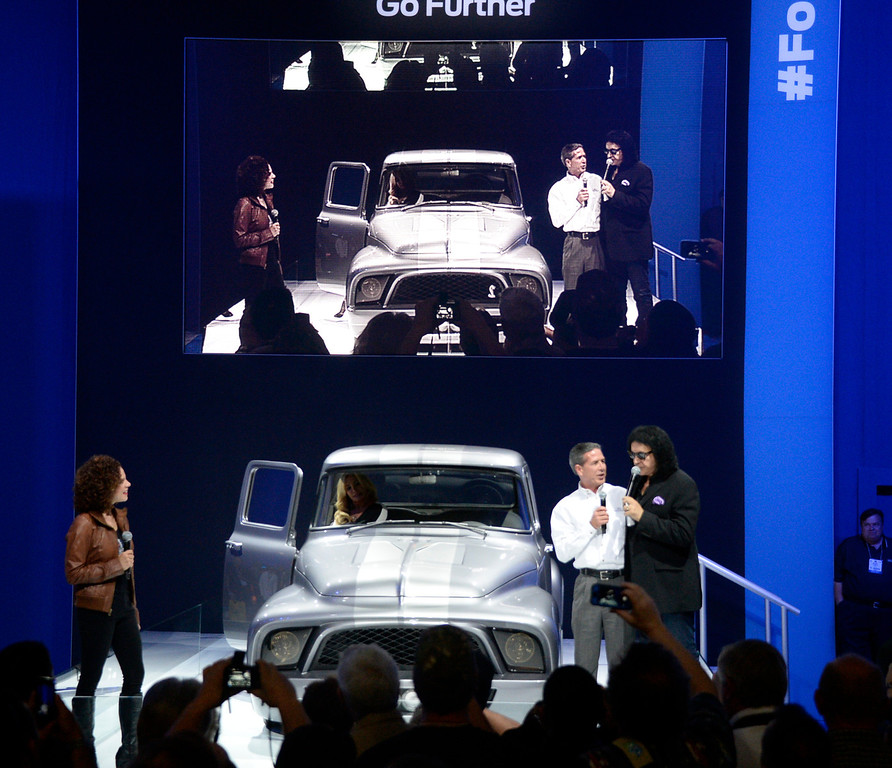 . Nov 5,2013 Las Vegas NV. USA. KISS front man Gene Simmons (R.) with Ford\'s John Felice, Vice President U.S. Marking Sales introduce their customized 1956 F-100 pickup, to be auctioned off for charity in Jan 2014 at the 2014 Barrett-Jackson Auction in AZ,  during the first day of the 2013 SEMA auto show.