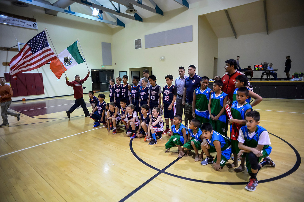 """. Triqui kids basketball team, from the mountainous region of Oaxaca, Mexico, who have been called the \""""Barefoot Champions of the Mountain,\"""" are known throughout their native Mexico for playing basketball without shoes took on the local Top Flight boys team at the Pacific Boys Lodge in Woodland Hills, CA Wednesday, December 18, 2013.  Before the game teams pose together for photos.  (Photo by David Crane/Los Angeles Daily News)"""