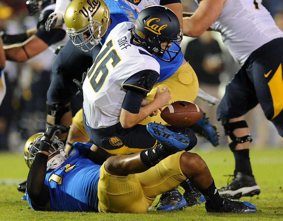 . UCLA linebacker Anthony Barr (11) sacks California quarterback Jared Goff (16) to cause a fumble during the first half of their college football game in the Rose Bowl in Pasadena, Calif., on Saturday, Oct. 12, 2013. California recovered their fumble.   (Keith Birmingham Pasadena Star-News)