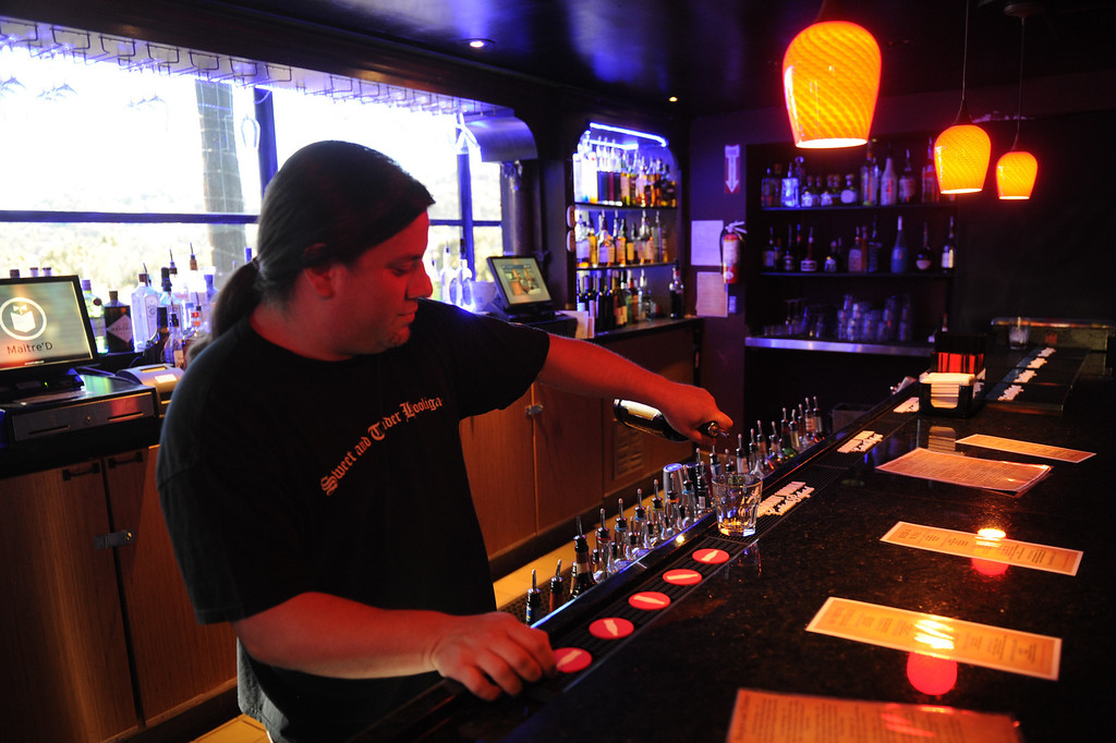 . Willie Torres tends bar at the Jon Lovitz Comedy Club at Universal CityWalk. Friday, June 28, 2013. (Michael Owen Baker/L.A. Daily News)