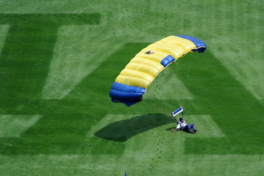 . A skydiver lands on the L.A. logo in center field at the Dodgers home opener, Friday, April 4, 2014, at Dodger Stadium. (Photo by Michael Owen Baker/L.A. Daily News)