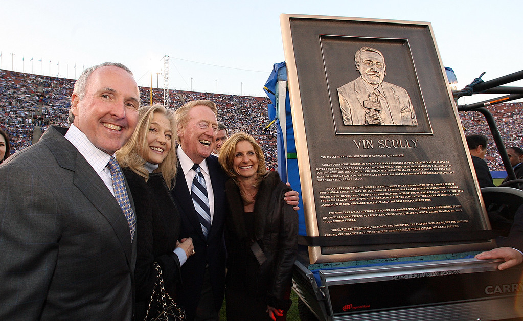 . The Dodgers long time Hall of Fame broadcaster Vin Scully was honored during pre-game ceremonies for his six-decades of service to the Dodgers with a commemorative bronze plaque at the peristyle entrance to the coliseum. Scully called games at the coliseum from 1958-1961 and his 59 years of service is a Major League Record. The Dodgers celebrating there 50th season in Los Angeles played an exhibition game against the Boston Redsox\'s March 29. 2008 at the Los Angeles Memorial Coliseum. (SGVN/Staff Photo Keith Birmingham/SXSports)