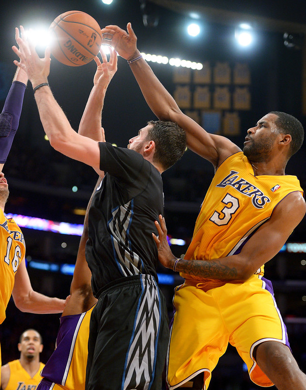 . The Lakers\' Shawne Williams gets the ball and the head of  the Timberwolves\' Kevin Love in the fourth quarter, Friday, December 20, 2013, at Staples Center. (Photo by Michael Owen Baker/L.A. Daily News)