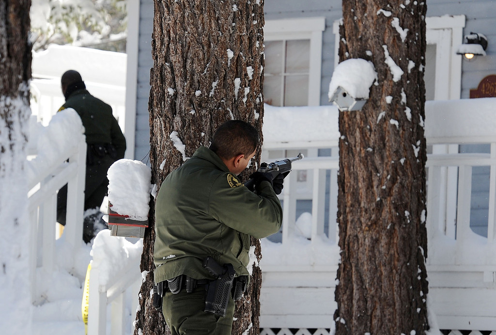 . San Bernardino County Sheriff deputies continue to search door-to-door in Big Bear for ex-LAPD fugitive Christopher Jordan Dorner Saturday February 9, 2013. Search conditions improved Saturday as skies cleared in the area after a heavy winter storm dropped over a foot of snow in the mountain community Friday. (Staff photo by Will Lester/Inland Valley Daily Bulletin)