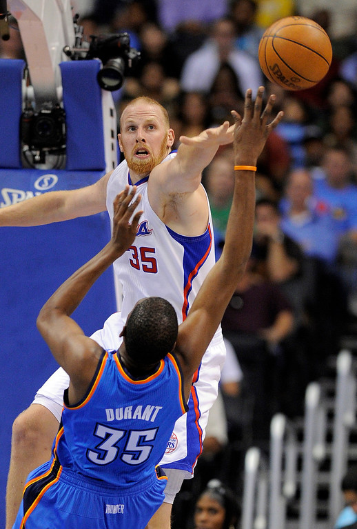. Los Angeles Clippers center Chris Kaman, top, blocks a shot by Oklahoma City Thunder forward Kevin Durant during the first half of an NBA basketball game, Wednesday, Nov. 3, 2010, in Los Angeles.  (AP Photo/Mark J. Terrill)