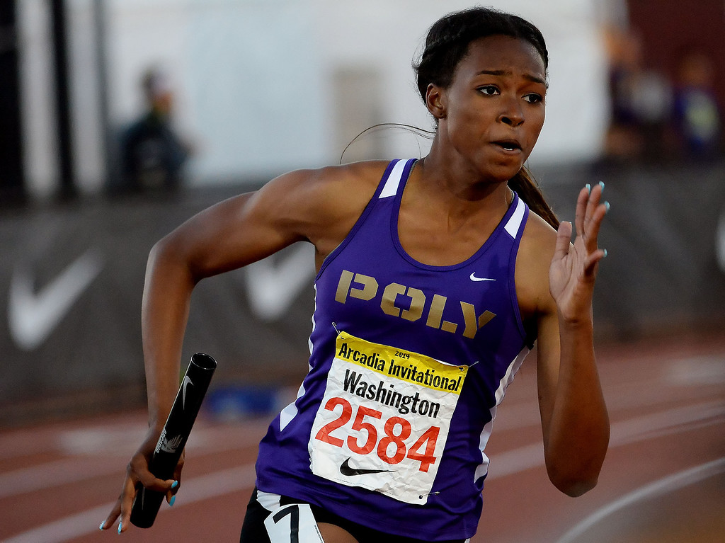 . Long Beach Poly\'s Arianna Washington in the 800 Sprint Medley Invitational during the Arcadia Invitational track and field meet at Arcadia High School in Arcadia, Calif., on Friday, April 11, 2014. Long Beach Poly won the race.  (Keith Birmingham Pasadena Star-News)