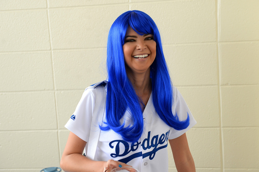. Breeona Mesa, of LaVerne, wears a blue wig to the Dodgers opener, Friday, April 4, 2014, at Dodger Stadium. (Photo by Michael Owen Baker/L.A. Daily News)