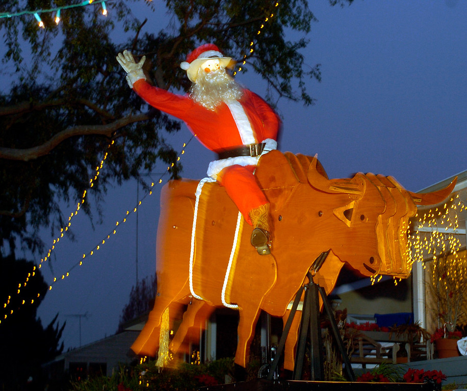 . NWS-XMAS-SH. DAILY BREEZE Photo by sean hiller.DEC. 23, 2005. Santa Claus trades in the sleigh and reindeer for a mechanical bull at this holiday display in the Sleepy Hollow neighborhood of Torrance Friday evening.