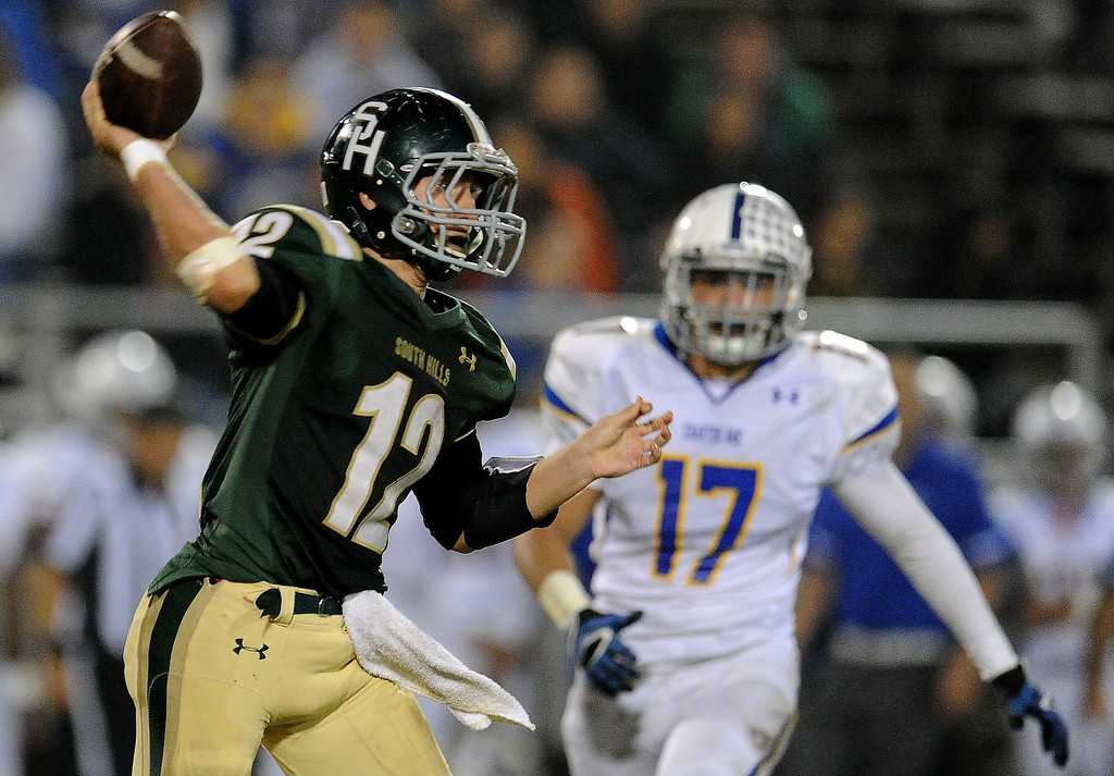 . South Hills quarterback Adam Goss (12) passes as Charter Oak\'s Jason Ortiz (17) looks on in the second half of a prep football game at Covina DIstrict Field in Covina, Calif., on Thursday, Oct. 24, 2013. 