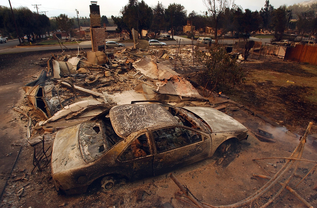 . Ten years ago this month the arson caused Old Fire, fanned by Santa Ana winds burned thousands of acres, destroyed hundreds of homes and caused six deaths. The fire burned homes in San Bernardino, Highland, Cedar Glen, Crestline, Running Springs and Lake Arrowhead and forced the evacuation of thousand of residents. A home in the 1500 block of 39th Street and many other homes in the background were destroyed by the Old Fire. (Staff file photo/The Sun)