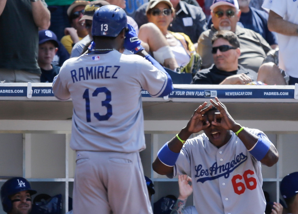 . Los Angeles Dodgers\' Hanley Ramirez is met by Yasiel Puig after his home run against the San Diego Padres in the ninth inning of a baseball game in San Diego, Sunday, June 23, 2013. (AP Photo/Lenny Ignelzi)