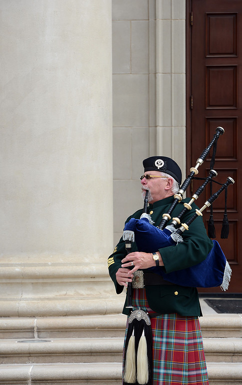 . Richard Cook, of Tustin, plays Amazing Grace on the Scottish Bagpipes during a memorial service for fallen service members was held Friday May 17, 2013 in front of the Memorial Chapel at the university. The ceremony featured a special tribute to Keith Taylor, a University of Redlands alumnus and father of a University of Redlands student. He was killed serving in Iraq. (Rick Sforza/Staff photographer, Redlands Daily Facts)