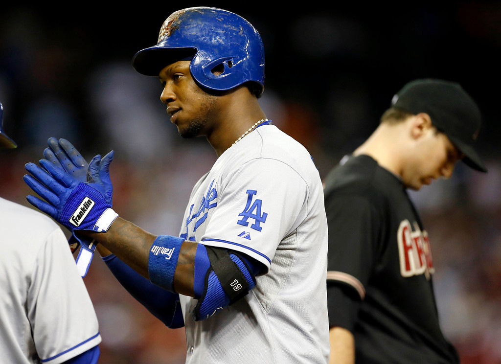 . Arizona Diamondbacks pitcher Heath Bell, right, looks  away as Los Angeles Dodgers Hanley Ramirez cheers to his bench after hitting a base hit during the ninth inning of a baseball game, Wednesday, July 10, 2013, in Phoenix. (AP Photo/Matt York)