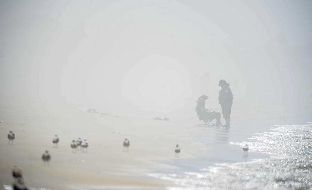 . Visibility was cut way down as hot Santa Ana winds from the east kick up the sand in Long Beach, CA on Tuesday, May 13, 2014. Beach crowds were kept small as wind-driven sand blasted bikers and beach goers. (Photo by Scott Varley, Daily Breeze)