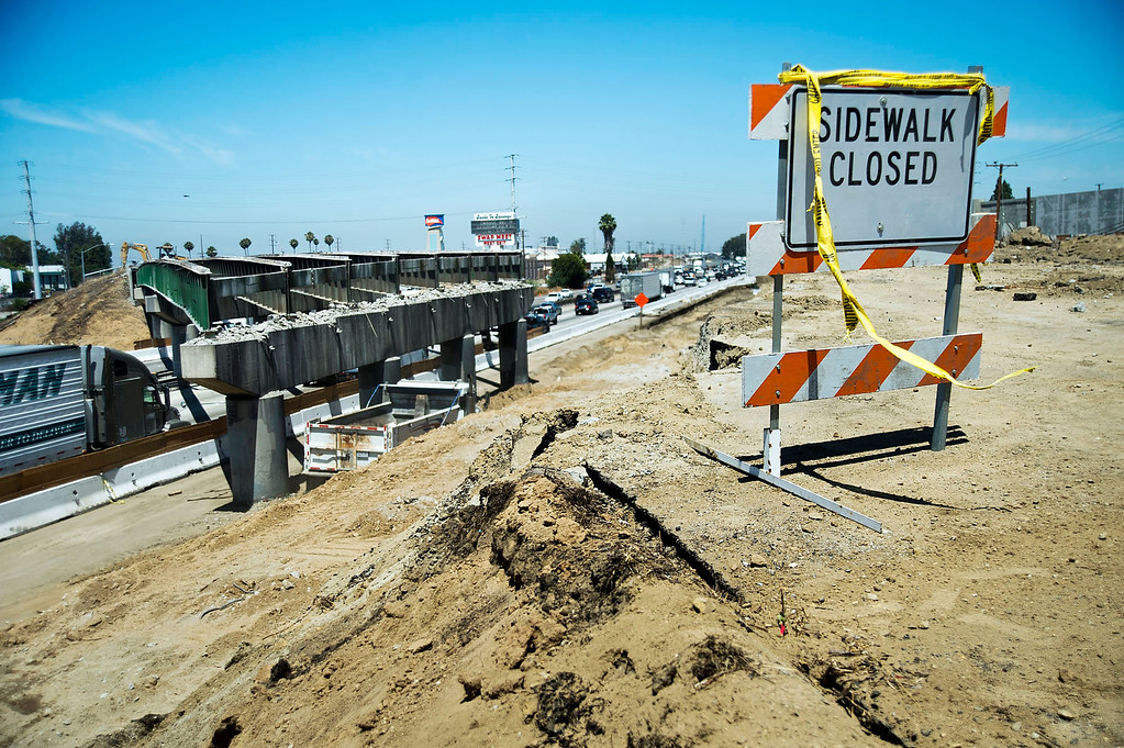 . Crews work to repair streets near the 5 Freeway while work continues to widen the freeway in Santa Fe Springs on Friday, June 28, 2013. La Mirada and Santa Fe Springs are receiving a total of about $5 million from the Metropolitan Transportation Authority to repair streets near the 5 Freeway and Alondra Boulevard. (SGVN/Staff photo by Watchara Phomicinda)