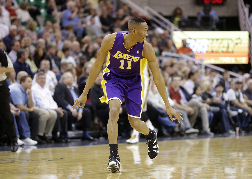 . Los Angeles Lakers\' Wesley Johnson (11) celecrates after hitting a 3-pointer in the second half during an NBA basketball game against the Utah Jazz Monday, April 14, 2014, in Salt Lake City, Utah. (AP Photo/Rick Bowmer)