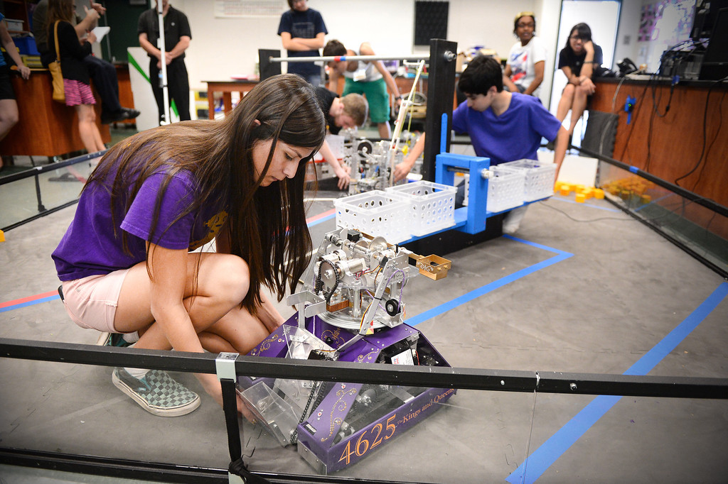 """. Jordan Nuñuz, 17, of The King and Queens, of Monrovia High\'s Robotics, sets up her team\'s robot \""""Your Heiness\"""" as they practice for the World Championships Tuesday, April 8, 2014. The King and Queens, an all girl team, qualified to advance to the 2014 First Tech Challenge Robotics World Championships after competing in the West Super-Regional Robotics Tournament at McClellan Air Force Base this past weekend. The Monrovia team, the only qualifier from the Los Angeles area, joins three San Diego teams and four Northern California teams to be among the 128 top teams from around the world to compete at the First Robotics World Championships. (Photo by Sarah Reingewirtz/Pasadena Star-News)"""