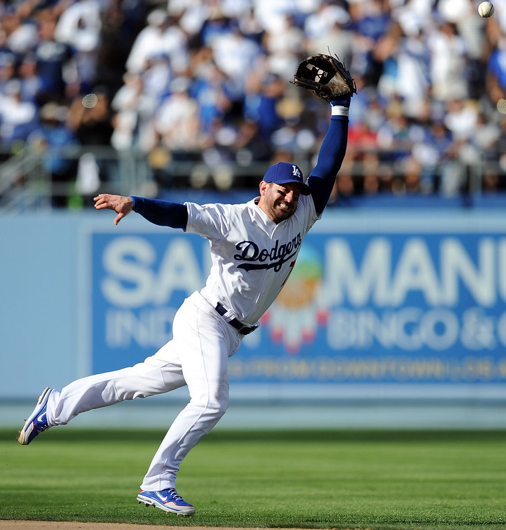 . The Dodgers\' Nick Punto goes up for a Cardinals\' Matt Adams hit in  the 9th during game 5 of the NLCS at Dodger Stadium Wednesday, October 16, 2013. The Dodgers beat the Cardinals 6-4. (Photo by Hans Gutknecht/Los Angeles Daily News)