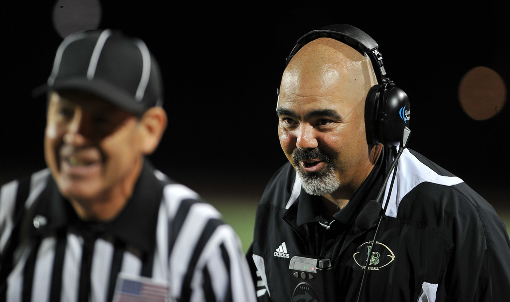 . 10/26/12 - Coach Raul Lara putting a few words in the refs ear.  The final score is 48 Poly 6 Wilson. Photo by Brittany Murray / Staff Photographer