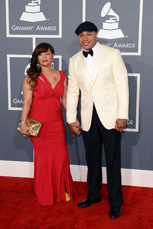 . Rapper/actor LL Cool J (R) and wife Simone Johnson arrive at the 55th Annual GRAMMY Awards at Staples Center on February 10, 2013 in Los Angeles, California.  (Photo by Jason Merritt/Getty Images)