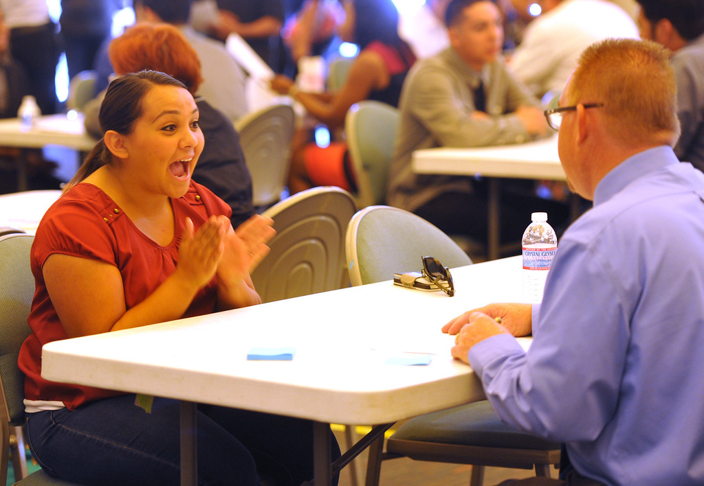 . Brittany Hernandez, of Montebello, is happy after her interview with General Manager Steve Morgan during a hiring event for new Norm\'s Restaurant at Pico Park in Pico Rivera on Friday  May 2, 2014. Over 1,000 people are expected to fill out applications for the Pico Rivera Norms that will open on May 22nd.  (Staff Photo by Keith Durflinger/Whittier Daily News)