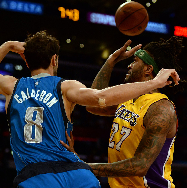. Los Angeles Lakers forward Jordan Hill (27) loses the ball against Dallas Mavericks guard Jose Calderon (8) in the first quarter during an NBA basketball game in Los Angeles, Calif., on Friday, April 4, 2014.  (Keith Birmingham Pasadena Star-News)