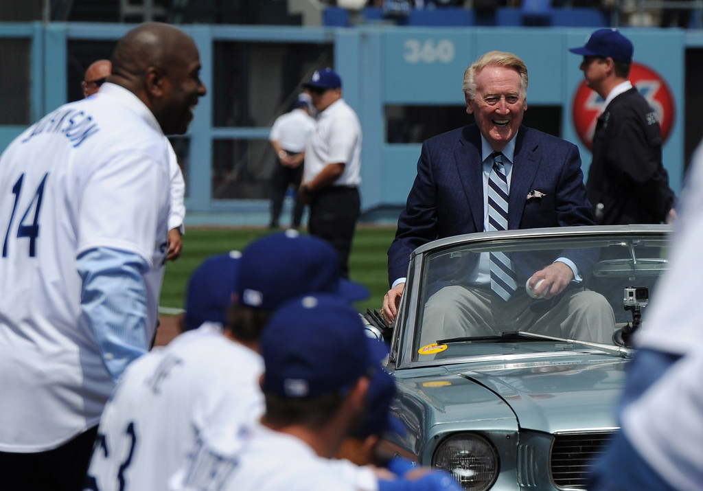 . Magic Johnson looks over at Vin Scully as he arrives in a vintage Ford Mustang to present the game ball. The Dodgers played the San Francisco Giants on Opening Day at Dodger Stadium. Los Angeles, CA. April 3, 2014 (Photo by John McCoy / Los Angeles Daily News)