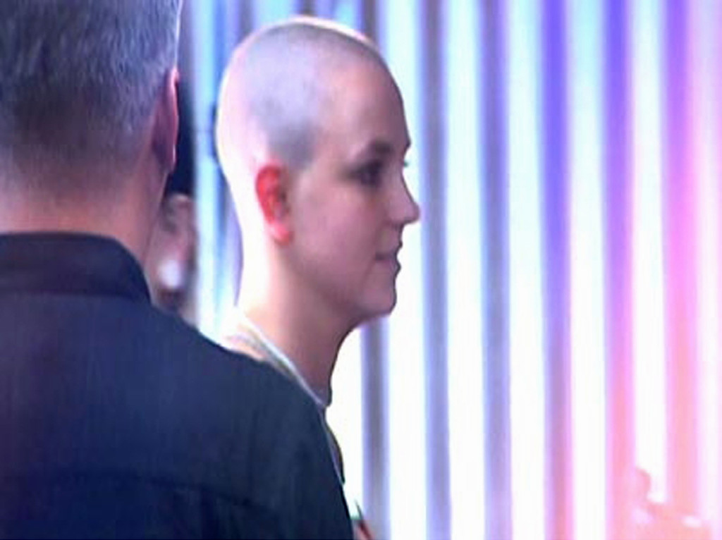 . In this photo made from video provided by KABC-TV, Pop singer Britney Spears is at a Sherman Oaks, Calif., tattoo parlor Friday night, Feb. 16, 2007. Spears was there to get a couple of tiny tattoos on her wrist, a pair of pink and red lips, according to KABC-TV. (AP Photo/KABC-TV)