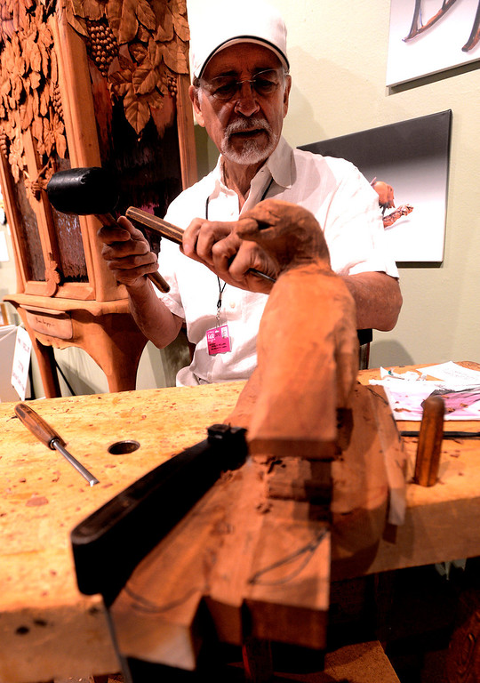 . Osvaldo Orellana, of Claremont, works on a Mahogany wood sculpture at the Fine Arts Building during the 91st Annual  Los Angeles County Fair in Pomona September 1, 2013. GABRIEL LUIS ACOSTA/STAFF PHOTOGRAPHER.