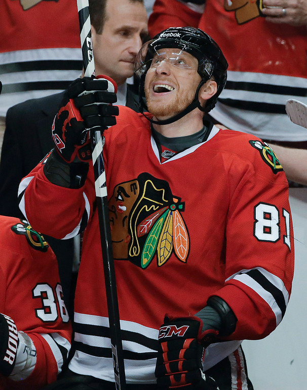 . Chicago Blackhawks right wing Marian Hossa smiles after scoring against the Los Angeles Kings during the second period of Game 1 of the NHL hockey Stanley Cup Western Conference finals, Saturday, June 1, 2013, in Chicago. Chicago won 2-1. (AP Photo/Nam Y. Huh)