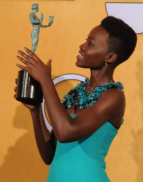 . Lupita Nyong\'o as she arrives backstage at the 20th Annual Screen Actors Guild Awards  at the Shrine Auditorium in Los Angeles, California on Saturday January 18, 2014 (Photo by John McCoy / Los Angeles Daily News)