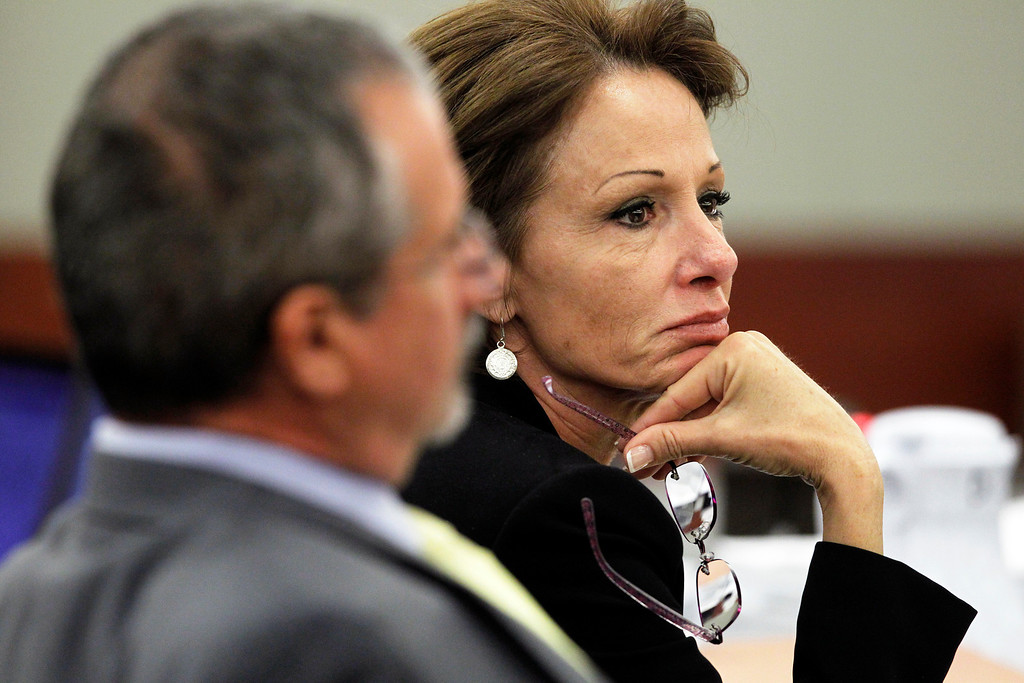 . Patricia Palm, O.J. Simpson\'s attorney, listens to testimony during an evidentiary hearing for Simpson in Clark County District Court on Tuesday, May 14, 2013 in Las Vegas.  The hearing is aimed at proving Simpson\'s trial lawyer, Yale Galanter, had conflicted interests and shouldn\'t have handled Simpson\'s case. Simpson is serving nine to 33 years in prison for his 2008 conviction in the armed robbery of two sports memorabilia dealers in a Las Vegas hotel room. (AP Photo/Steve Marcus, Pool)