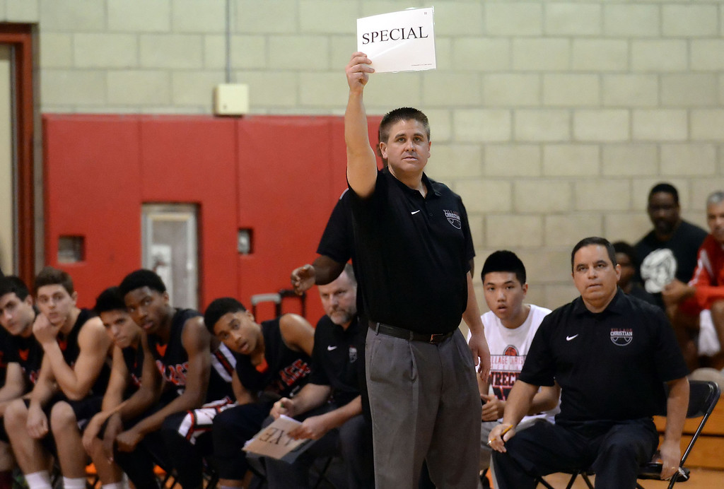 . Village Christian head coach Jon Shaw holds a sign in the second half of a State Division 4 CIF Prep Playoff Basketball game against Cantwell at Whittier High School in Whittier, Calif., on Saturday, March 15, 2014. Cantwell won 51-48.  (Keith Birmingham Pasadena Star-News)