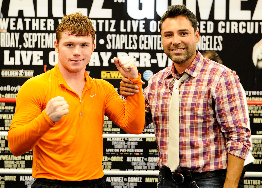 . (R)Former professional boxer and promoter Oscar De La Hoya poses with Mexico\'s Canelo Alvarez, as Oscar made his first public appearance after being in rehab for several months. Oscar De La Hoya has fully recovered from his substance abuse and is back to promote boxing with his company Golden Boy Productions that has two big fights coming up in Los Angeles and Las Vegas on September 17th. Big Bear Lake, CA. Aug 23, 2011.photo by Gene Blevins/LA DAILY NEWS