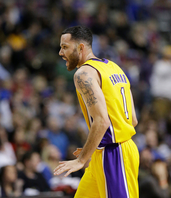. Los Angeles Lakers guard Jordan Farmar (1) reacts after a basket during the second half of an NBA basketball game against the Detroit Pistons at the Palace in Auburn Hills, Mich., Friday, Nov. 29, 2013. (AP Photo/Carlos Osorio)