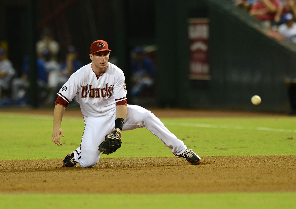 . PHOENIX, AZ - SEPTEMBER 16:  Paul Goldschmidt #44 of the Arizona Diamondbacks makes a play on a ground ball against the Los Angeles Dodgers at Chase Field on September 16, 2013 in Phoenix, Arizona.  (Photo by Norm Hall/Getty Images)
