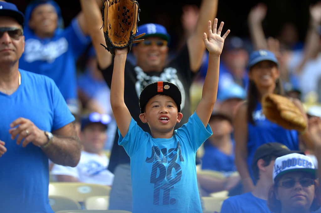 . A youngster hopes for a ball during the Dodger game September 1, 2013.  The Dodgers beat the Padres 2-1.  (Andy Holzman/Los Angeles Daily News)