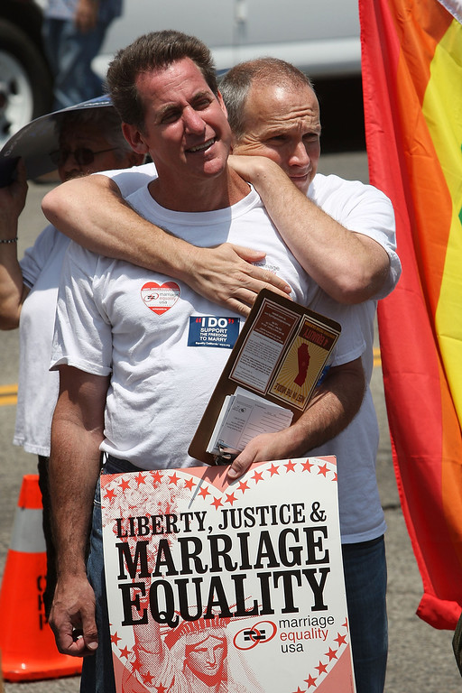 . LOS ANGELES, CA - MAY 26:  Supporters of same-sex marriage rally outside the East Los Angeles Recorder Office following the California Supreme Court ruling to uphold Proposition 8 May 26, 2009 in Los Angeles, California. The court voted 6-1 to uphold Proposition 8, which makes it illegal for same-sex couples to marry in the state of California, although the more than 18,000 same-sex couples that wed before Prop 8 was voted in will still be legally married.  (Photo by David McNew/Getty Images)