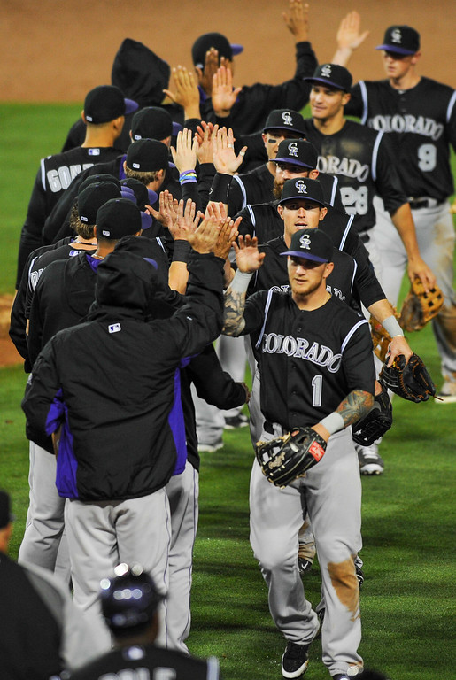 . The Rockies celebrate after beating the Dodgers 5-4 in 11 innings, Friday, April 25, 2014, at Dodger Stadium. (Photo by Michael Owen Baker/L.A. Daily News)