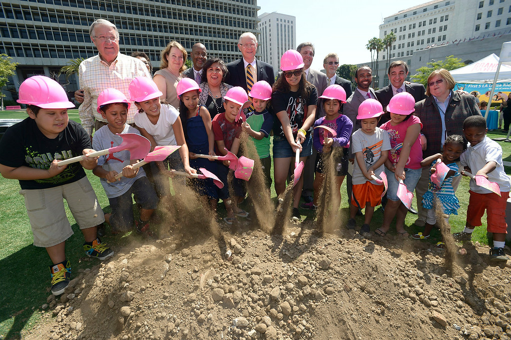 . Children from Casa Cultura Saybrook Park in Los Angeles join representatives from the County of Los Angeles, First 5 LA, Grand Park and The Music Center to break ground for the Park�s innovative new play area.  The play area is slated to open in November 2014. Los Angeles, CA. 7/30/2014(Photo by John McCoy Daily News)