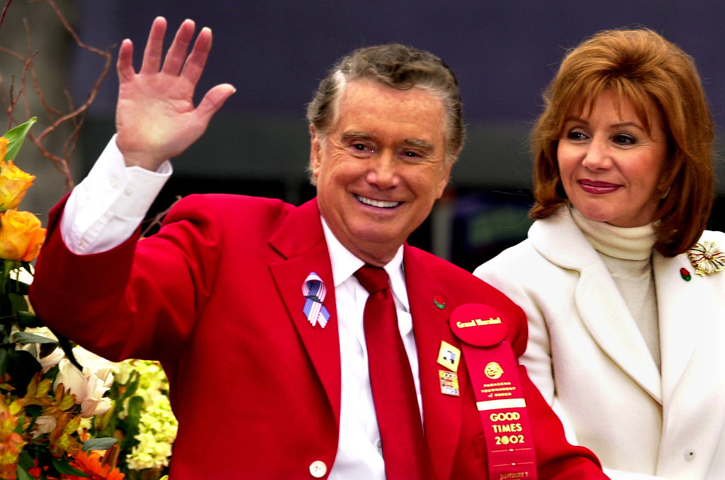 . Regis Philbin (Grand Marshal) joined by his wife Joy, riding in  decorated vehicle at Rose Parade) (Photo by Walt Mancini/Pasadena Star News)