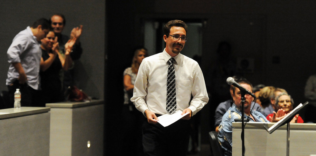 . Arcadia girls cross-country coach Michael Feraco-Eberle prepares to speak as over 200 people crowded the Arcadia Unified School District Performing Arts Center as a show of support for fired Arcadia High School cross-country coach James O\'Brien during a Arcadia Unified School District Board of Education meeting on Tuesday, July 23, 2013 in Arcadia, Calif. O\'Brien, led the team to two time state and national championships.  (Keith Birmingham/Pasadena Star-News)