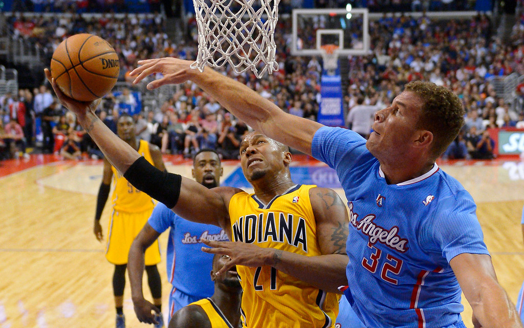 . Indiana Pacers forward David West, left, puts up a shot as Los Angeles Clippers forward Blake Griffin defends during the second half of an NBA basketball game, Sunday, Dec. 1, 2013, in Los Angeles. (AP Photo/Mark J. Terrill)