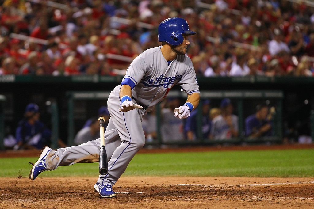 . Skip Schumaker #55 of the Los Angeles Dodgers hits an RBI single against the St. Louis Cardinals  in the sixth inning at Busch Stadium on August 7, 2013 in St. Louis, Missouri.  Dodgers won 13-4.  (Photo by Dilip Vishwanat/Getty Images)